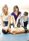 Teenagers Practice CPR Portrait